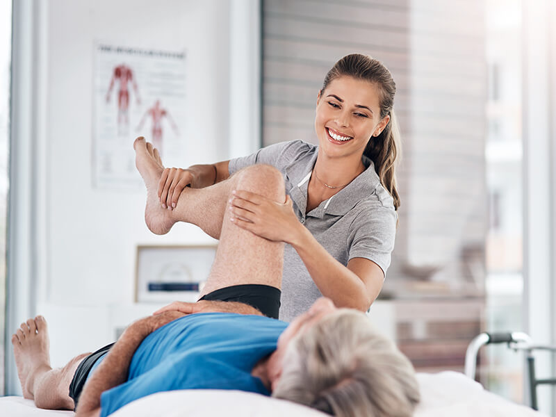 A chiropractor adjusts a patient