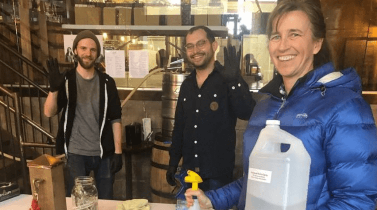 Staff at Vikre Distillery pose in their facility