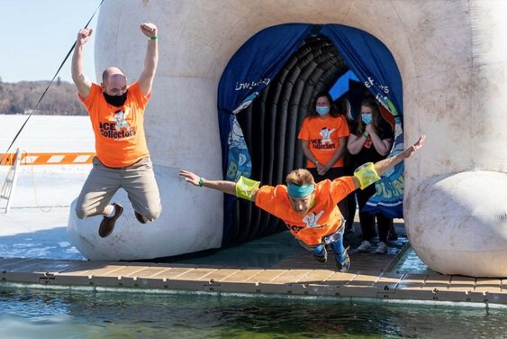IC System Team member jumps into the lake for the 2021 Polar Plunge